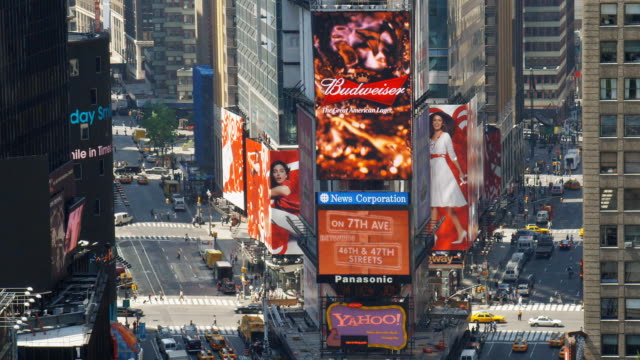 Large video monitors play commercials at the intersection of Broadway and 7th Avenue in Times Square in New York City.