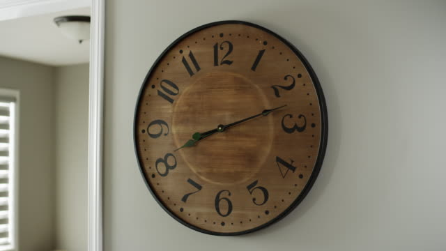 large wall clock, hands are animated stop-motion from 8:11 to 8:13 to 8:14 to 8:15 to 8:16 to 8:17 to 8:18 to 8:19. - elkhorn nebraska stock videos & royalty-free footage