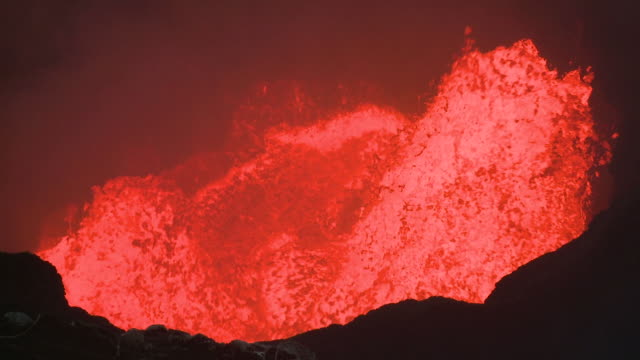 large wave of lava explodes from lava lake onto crater wall, marum volcano, ambrym island, vanuatu - explosion wall stock videos and b-roll footage