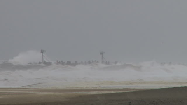 Large waves and 40 to 60mph winds batter the Jersey Shore during a noreaster