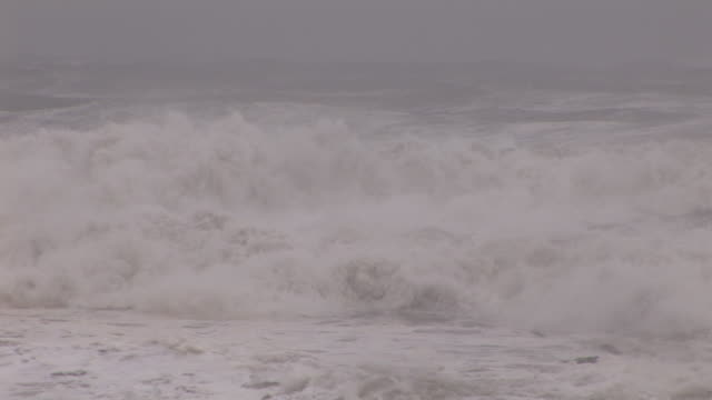 large waves crash along the shores of long beach, ny as hurricane irene makes landfall in the new york city / long island area. - hurricane irene stock videos & royalty-free footage