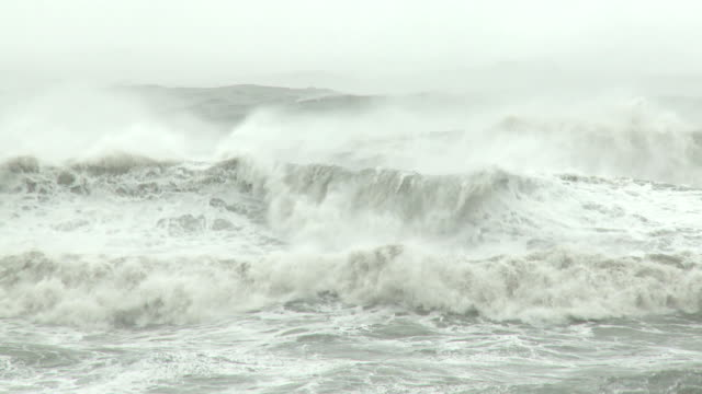 large waves crash ashore in hurricane - tropical storm stock videos & royalty-free footage