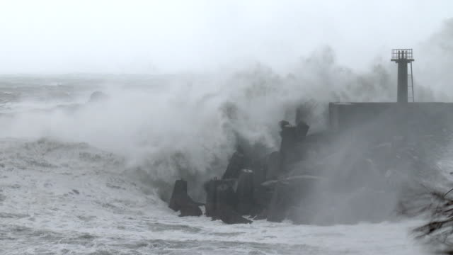 large waves crash into small port in taiwan as typhoon dujuan nears landfall on 28th september 2015 - pacific ocean stock videos & royalty-free footage