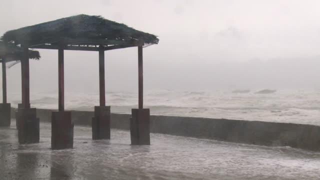 large waves crash over sea wall as typhoon megi or juan hits coast, ne luzon, philippines oct 2010 / audio - luzon stock videos & royalty-free footage