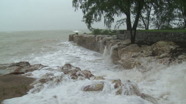 large waves crash towards camera during cyclone carlos in darwin / audio - cyclone stock videos and b-roll footage