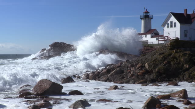 large waves crashing around the eastern point lighthouse - gloucester massachusetts stock videos & royalty-free footage