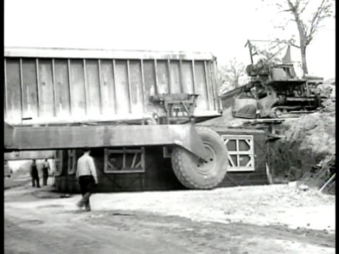 tournalayer large wheeled machine moving over framed structure concrete being dumped on top of structure 'tournalayer' machine moving off formed... - 1946 stock videos and b-roll footage