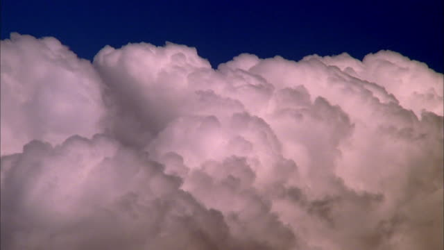 large white clouds billow against bright blue sky, maui available in hd. - roll over stock videos and b-roll footage