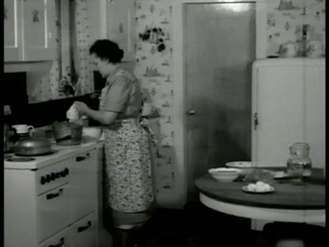 'walker' home kitchen ws large white house trees int 'mrs freda walker' in kitchen cu freda preparing food ms freda retrieving item from deep freezer... - homemaker stock videos and b-roll footage