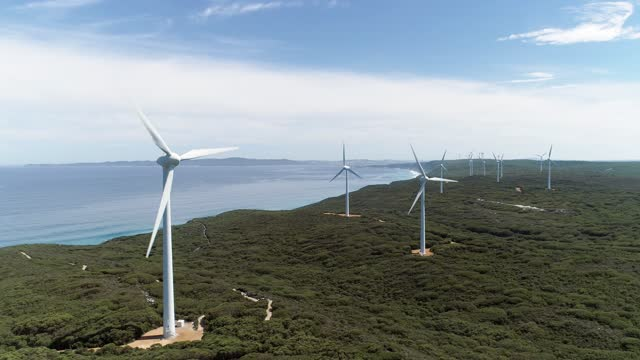 large wind turbines on coastal cliffs - renewable energy stock videos & royalty-free footage