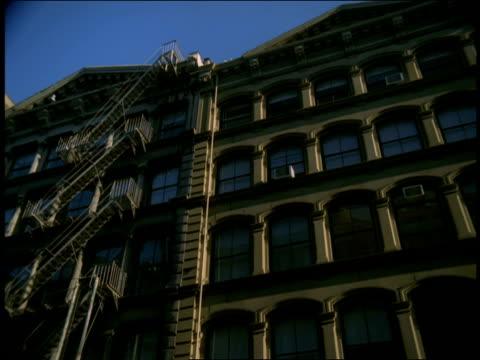 Large windows cover loft apartment buildings in SoHo, Manhattan.