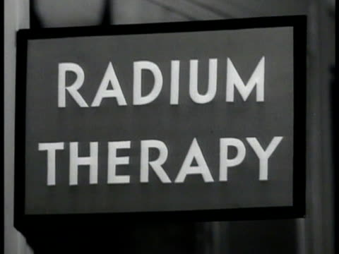 large x-ray machine over patient dial output meter technician w/ controls outside room. radium therapy machine. ext memorial hospital new york.... - radiation stock videos & royalty-free footage