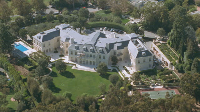 large yards surround a mansion. - beverly hills california stock-videos und b-roll-filmmaterial