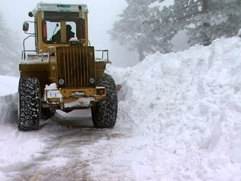 large yellow snow plow in action - snow vehicle stock videos and b-roll footage