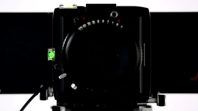 hd large-format camera front view (4 clips) - bländare bildbanksvideor och videomaterial från bakom kulisserna