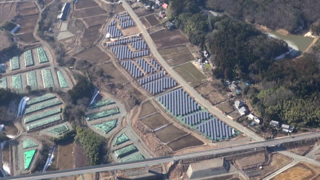 large-scale solar power plant was completed in okuma town in fukushima prefecture, japan, where all residents are still evacuated after the 2011... - atomkraftwerk stock-videos und b-roll-filmmaterial