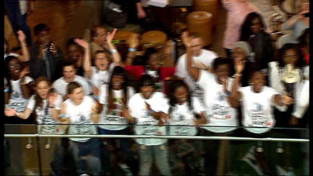 largest gospel choir world record attempt high angle view choir singing 'oh happy day' sot high angle view choir applauding themselves after record... - world record stock videos and b-roll footage