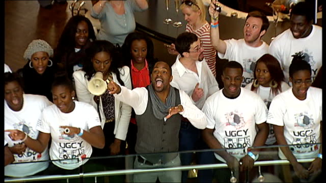 largest gospel choir world record attempt high angle view delisser leading universal gospel choir of the year in singing pull out - world record stock videos and b-roll footage