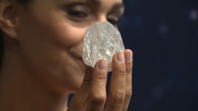 largest rough diamond 'lesedi la rona' goes up for auction; various of woman holding 'lesedi la rona' diamond rock hand holding diamond vox pop... - rau stock-videos und b-roll-filmmaterial