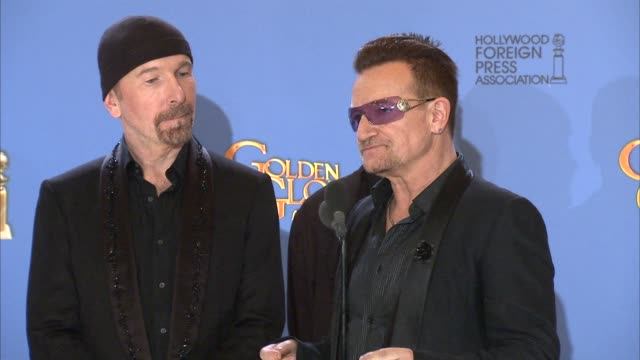 INTERVIEW Larry Mullen Jr Adam Clayton Bono and The Edge at the 71st Annual Golden Globe Awards Press Room at The Beverly Hilton Hotel on in Beverly...
