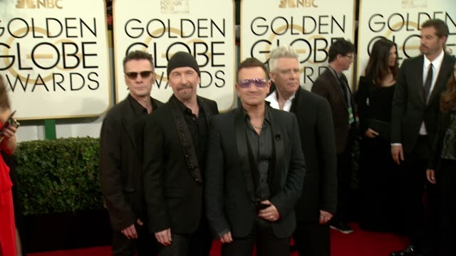 larry mullen jr bono adam clayton and the edge at the 71st annual golden globe awards arrivals at the beverly hilton hotel on in beverly hills... - david 'the edge' howell evans stock videos and b-roll footage