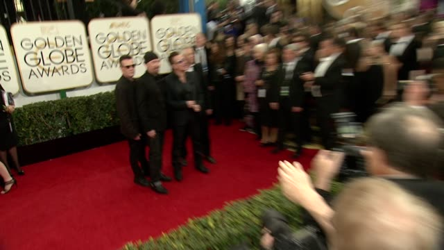 Larry Mullen Jr Bono Adam Clayton and The Edge at the 71st Annual Golden Globe Awards Arrivals at The Beverly Hilton Hotel on in Beverly Hills...
