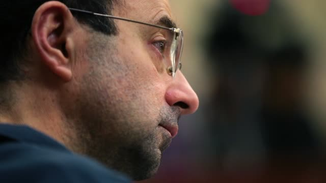 larry nassar listens to victim impact statements during his sentencing hearing after being accused of molesting more than 100 girls while he was a... - sexual violence stock videos & royalty-free footage