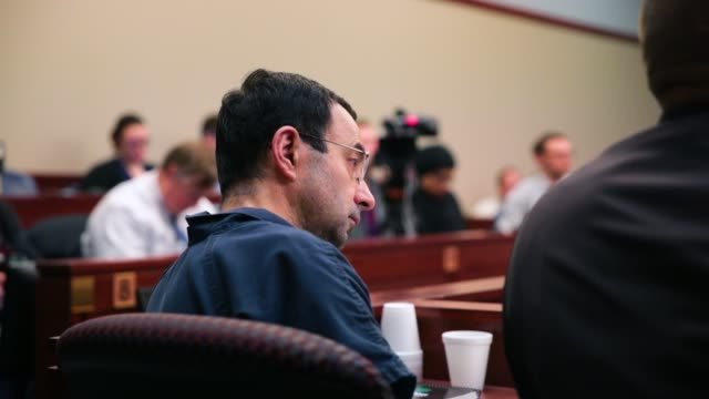 larry nassar listens to victim impact statements during his sentencing hearing after being accused of molesting more than 100 girls while he was a... - sentencing stock videos & royalty-free footage