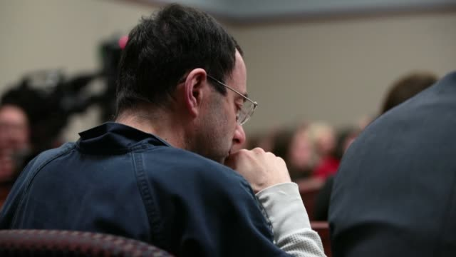 larry nassar listens to victim impact statements prior to being sentenced after being accused of molesting about 100 girls while he was a physician... - sentencing stock videos & royalty-free footage