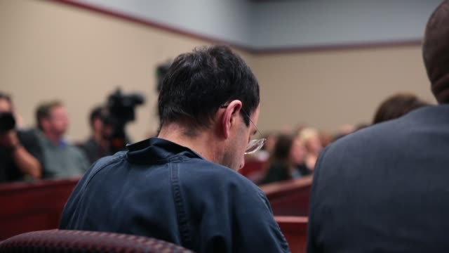 larry nassar listens to victim impact statements prior to being sentenced after being accused of molesting about 100 girls while he was a physician... - sexual violence stock videos & royalty-free footage