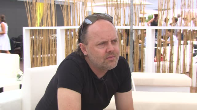 lars ulrich on being passionate about film at 'metallica' interviews at carlton beach on may 17, 2013 in cannes, france - メタリカ点の映像素材/bロール