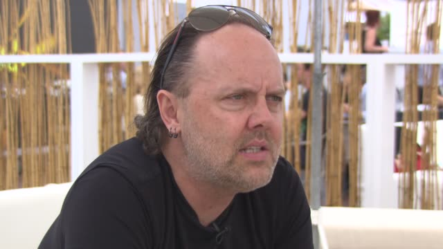 lars ulrich on if he will direct in the future at 'metallica' interviews at carlton beach on may 17, 2013 in cannes, france - メタリカ点の映像素材/bロール