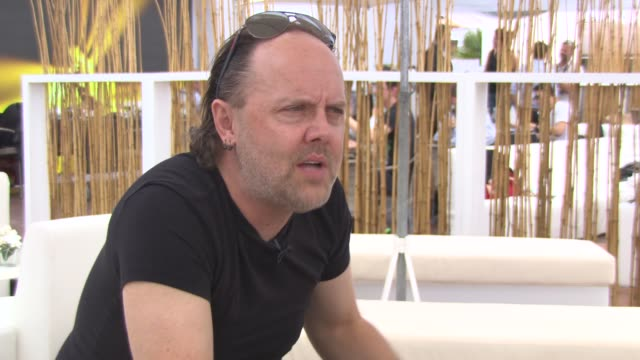 lars ulrich on their music, making a movie, working in a different environment at 'metallica' interviews at carlton beach on may 17, 2013 in cannes,... - メタリカ点の映像素材/bロール
