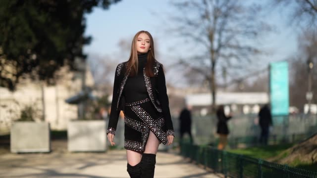 larsen thompson wears a black turtleneck top a bejeweled jacket with shoulder pads a skirt black thigh high boots outside elie saab during paris... - turtleneck stock videos & royalty-free footage