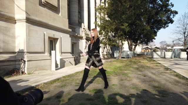 stockvideo's en b-roll-footage met larsen thompson wears a black turtleneck top a bejeweled jacket with shoulder pads a skirt black thigh high boots outside elie saab during paris... - coltrui