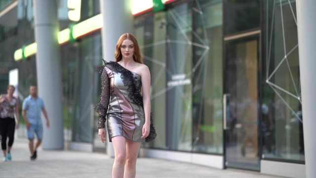 larsen thompson wears a one-shoulder silver and pink shiny dress with lace and a mesh sleeve, outside the alberta ferretti show during milan fashion... - milan fashion week stock videos & royalty-free footage