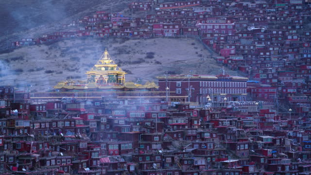 larung gar(larung five sciences buddhist academy). a famous lamasery in seda, sichuan, china. - lamasery stock videos and b-roll footage
