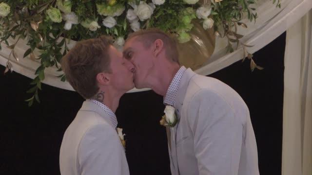 las dos primeras bodas gay de australia se celebraron el fin de semana tras la entrada en vigor de la ley de matrimonio igualitario aprobada por los... - entrada stock videos and b-roll footage