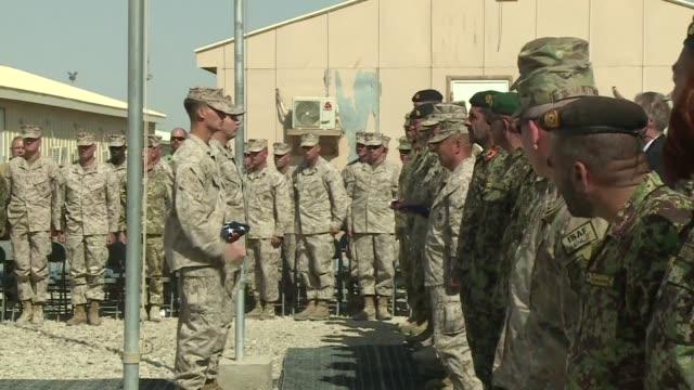 vídeos y material grabado en eventos de stock de las fuerzas britanicas y estadounidenses de la otan trasfirieron oficialmente este domingo el mando de la region de helmand al ejercito afgano - ee.uu