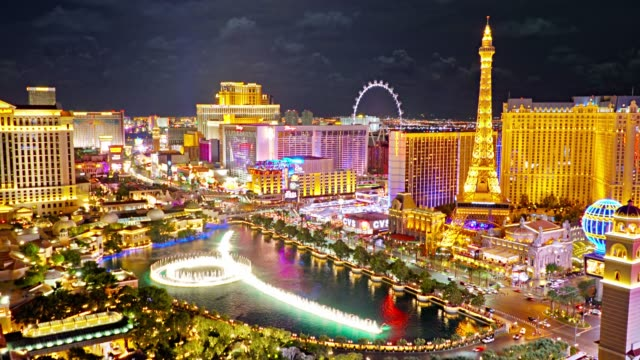 las vegas aerial view. fountain. eiffel tower. high roller observation wheel. night - panoramic stock videos & royalty-free footage