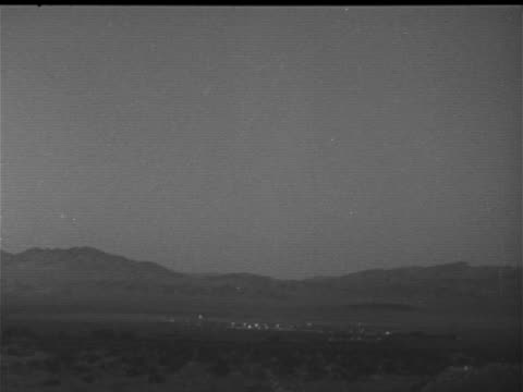 Las Vegas city w/ mountains BG darkness w/ FLASH landscape lighter second third FLASH Note Believed to be LIGHT EFFECT from test in Nye County Atomic...