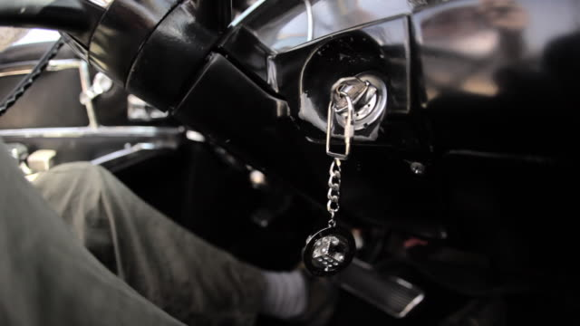 A Las Vegas keychain hangs from the ignition of a vehicle in motion.