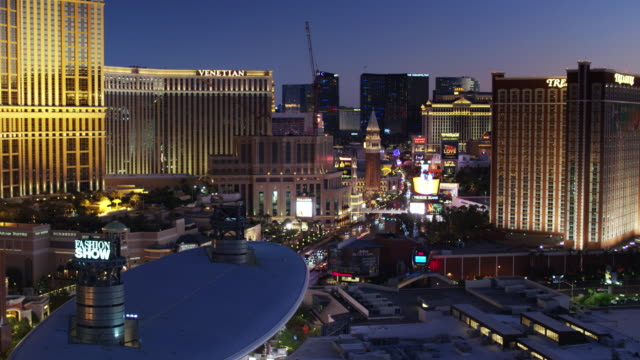 las vegas malls and casinos lit up at night - drone shot - venetian hotel las vegas stock videos & royalty-free footage