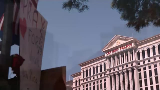 Donald Trump visit / girlfriend of gunman questioned by police USA Nevada Las Vegas EXT Flag with 'God bless' hand written message and Vegas hotels...