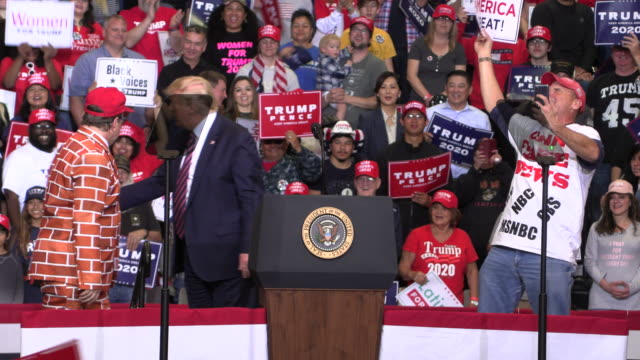 united states president donald j trump invites a man dressed as a brick wall onto the stage during a keep america great rally in las vegas on the eve... - political rally stock videos & royalty-free footage