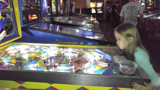 change machine at pin ball hall of fame clip 2 broll of the pinball hall of fame clip 3 broll of the pinball hall of fame clip 4 little girl playing... - pinball machine stock videos & royalty-free footage