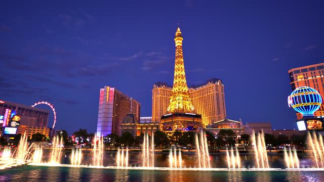 las vegas panorama. fountain and paris hotel - las vegas replica eiffel tower stock videos & royalty-free footage