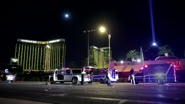 Investigation into gunman Stephen Paddock continues USA Nevada Las Vegas Police vehicles and ambulances on road with flashing lights Police officers...