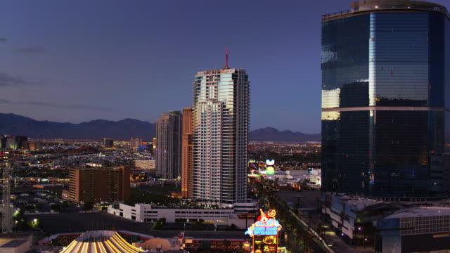 las vegas strip and sprawl at twilight - drone shot - las vegas stock videos & royalty-free footage