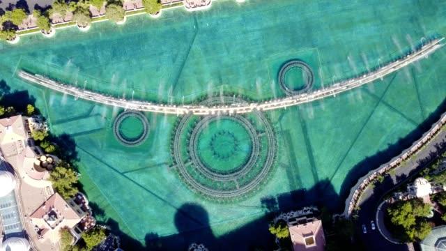 las vegas strip bellagio fountain birds eye view pirouette - fountain stock videos & royalty-free footage